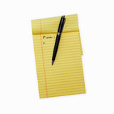 Pen laying on an opened note pad Stock Photos