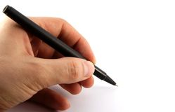 Pen in a left hand Royalty Free Stock Images