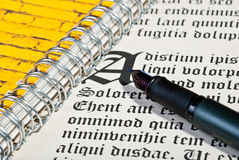 Pen and letter. Pen and ancient gothic text. Dummy text Lorem ipsum Stock Images