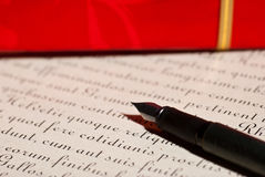 Pen and letter. Pen and ancient latin calligraphic text - letter Stock Image