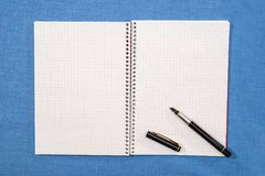 pen lies on empty pages Stock Image