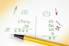 Pen lies on a sheet of paper with financial calculations. Expenses, receipts and profits.  stock photo