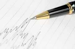 Pen and line graph Royalty Free Stock Photography