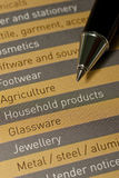 A pen and list of products and services Stock Images