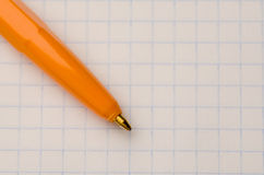 Pen located on the notebook sheet Royalty Free Stock Images