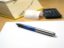 Pen lying on blank paper Royalty Free Stock Image