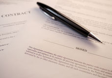 Pen lying on contract documents Stock Photography