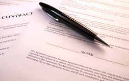 Pen lying on contract documents. Black pen on contract documents royalty free stock photo