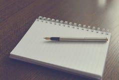 Pen 3. Pen lying on a notebook Stock Photos