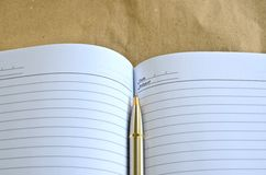 Pen lying on a notebook. For background Stock Image
