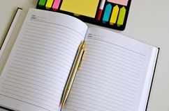 Pen lying on a notebook. Over white Stock Photo