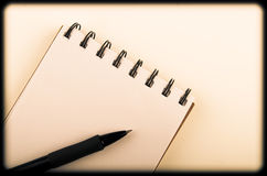 Pen lying on opened notebook. color toning Royalty Free Stock Images