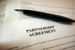 Pen lying on partnership agreement Royalty Free Stock Images