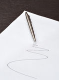Pen lying on a sheet of paper Royalty Free Stock Images