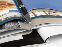 Pen and Magazines Royalty Free Stock Images