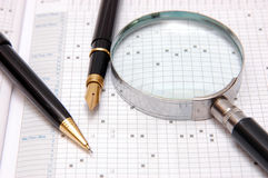 Pen,magnifier and organizer Stock Images