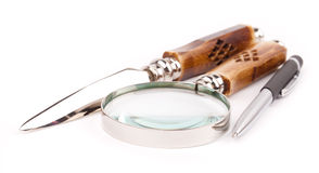 Pen and magnifing glass Stock Image