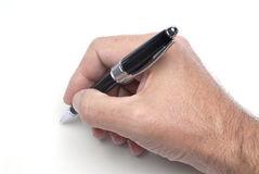 Pen and male hand Stock Photos