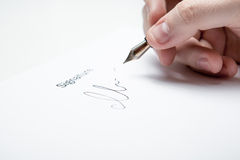 Pen in the man's hand and signature Royalty Free Stock Photo