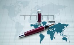 Pen, map and calc sheet. Red old pen over a world map and a calc sheet Stock Photography