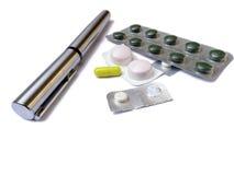Pen, medicines and pills Stock Photos