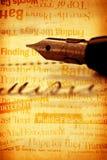 pen met boek Stock Foto