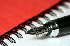 Pen met notitieboekje stock afbeelding