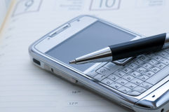 Pen and mobile phone Stock Photo