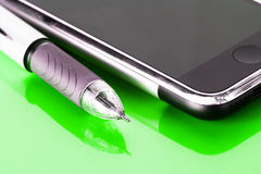 Pen and mobile phone Stock Photos