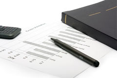 Pen, mobile phone, notebook and financial statement Royalty Free Stock Images