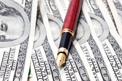 Pen on the money Royalty Free Stock Image