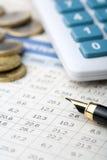 Pen, money and calculator Stock Photos
