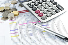 Pen, money and calculator placed on document Stock Photo