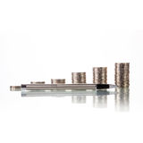 Pen with Money coins Royalty Free Stock Photos