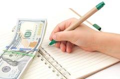 Pen and money Stock Photo