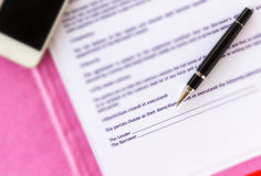 Pen on money loan or borrow document focussed at blank signature. Area royalty free stock images