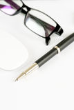 Pen, mouse and glasses, on a background Royalty Free Stock Images