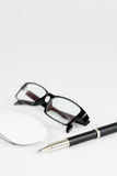 Pen, mouse and glasses, on a background Royalty Free Stock Photography