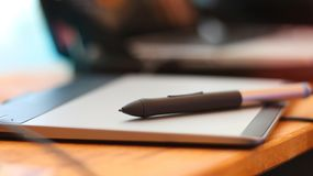Pen mouse wirless or digital pen on tablet board in office Royalty Free Stock Photos