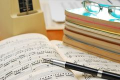 Pen on music score with music books Stock Photos