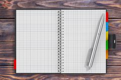 Pen near Black Leather Covered Personal Diary or Organiser Book. With Blank Pages for Yours Design over Wooden Table extreme closeup. 3d Rendering Stock Photography