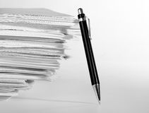 Pen near stack of paper. A pen near stack of paper Royalty Free Stock Photos
