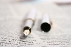 PEN ON A NEWSPAPER Royalty Free Stock Images