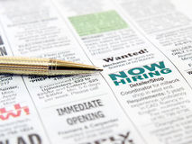 Pen on the newspaper. Career opportunity ad Royalty Free Stock Photos
