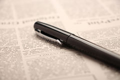Pen on newspaper Royalty Free Stock Images