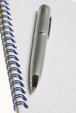 Pen and note Stock Images