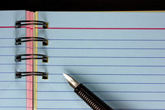 Pen and note book Stock Image