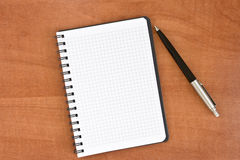 Pen and note-book Stock Image