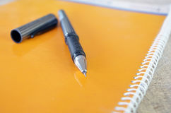 Pen on Note Book Royalty Free Stock Images