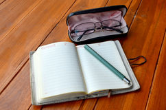 Pen on note book and Spectacles glasses Royalty Free Stock Photography